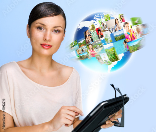 Woman holding her tablet computer and communicating