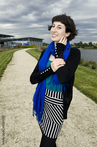 Beautiful young woman wearing blue scarf at vineyard