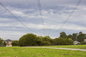 Overhead power lines against the backdrop of an evening sky