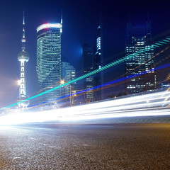 the light trails on the modern building background in shanghai .
