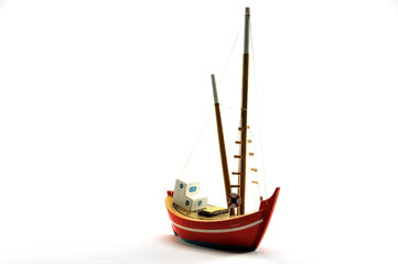 a small fishing boat toy