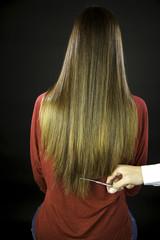 Hairdresser cuts long ruined hair