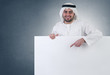 arabian business man pointing at a blank white sign