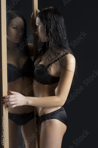 sexy woman next to mirror