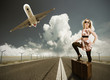 Beautiful blond girl posing on runway, concept of travel