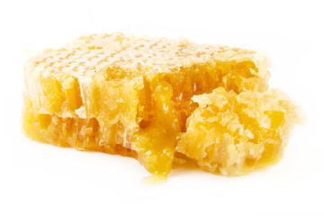 Slice of natural honeycomb over white