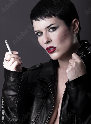 Naked Woman With Black Leather Jacket Smoking A Cigarette
