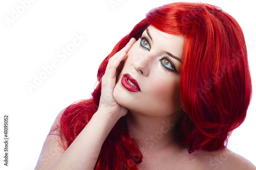 Beautiful girl with wavy red hair caressing his cheek