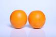 two fresh orange fruit in white
