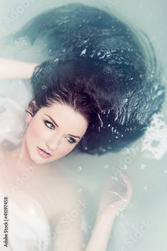 Woman relaxing in water
