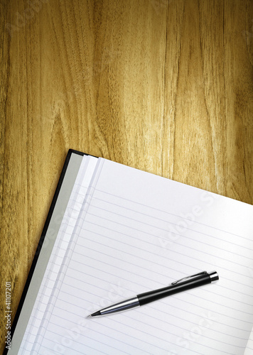 pen and notepad on desk