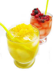 two fruit punch cocktail drinks with strawberry
