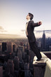 businessman standing on top of a building in NY city