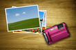 pink camera with photos