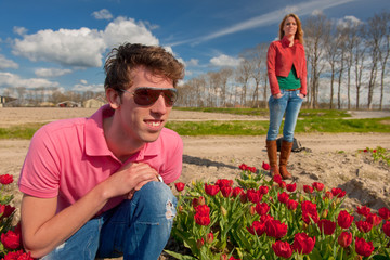 Young couple in flower fields