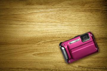 pink camera on desk