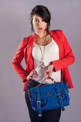 High Fashion Model Poses with handbag blue