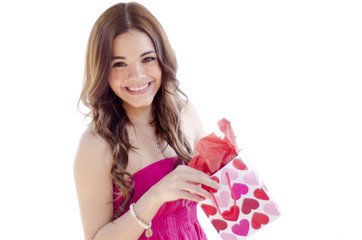 Young beautiful woman opening a present