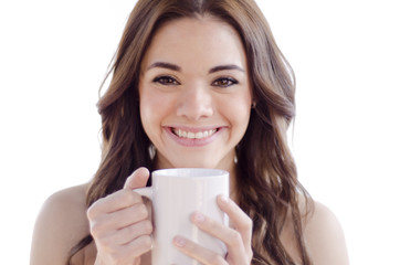 Cute girl drinking a cup of coffee
