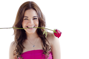 Beautiful woman holding a rose in her mouth