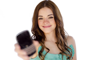 Cute young woman handing you a cell phone