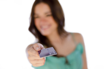 Cute girl paying with a credit card