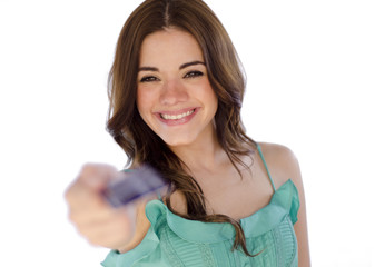 Cute young girl paying with a credit card