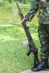 Gun in hand of soldier