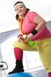 Fat woman in colorful sportswear