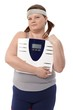 Fat woman holding a scale in hand