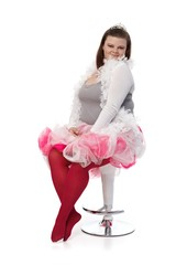 Plump woman in tiara and pink tutu