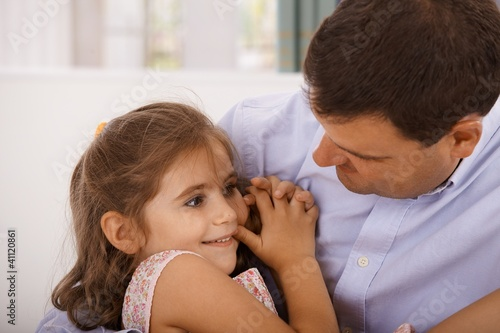 Father and little daughter embracing