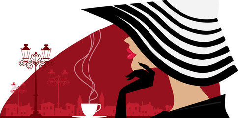 Stylish woman in a big hat at cafe