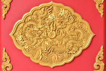 Gold dragon texture on Thai temple wall