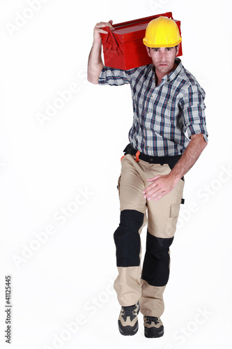 Worker running with a toolbox
