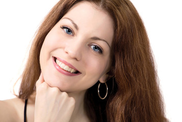 Smiling young woman with chin on hand face closeup