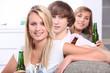 Three teenagers drinking beer