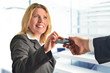 Attractive business woman giving credit card to a man