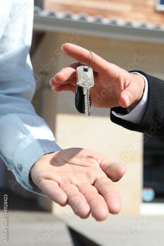 Agent handing over house keys