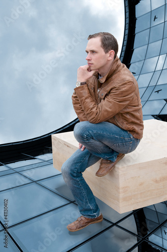 man thinks about the next step