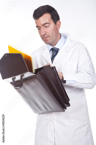 man  holding a briefcase and tooking some documents from inside