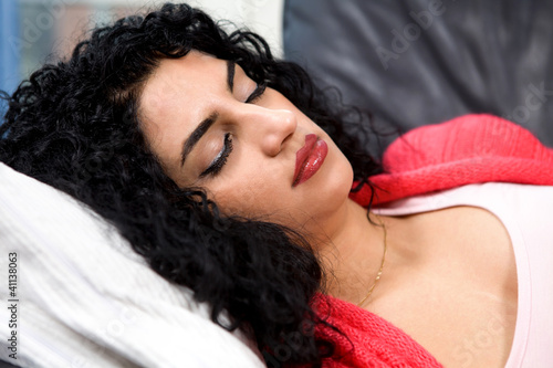 Stressed sleeping woman lying with eyes closed