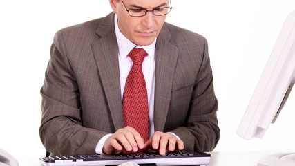 Businessman working with computer.
