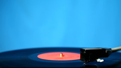 Close up of a vinyl deck playing a record