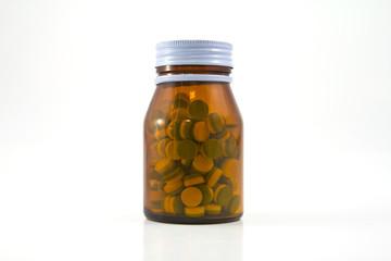 Medicine glass bottle with pills