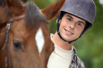 young man riding a horse