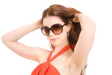 Beautiful summer fashion girl posing in sunglasses