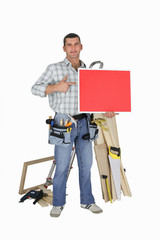 Carpenter holding red panel