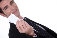 Man Holding Up A Blank Card Sticker