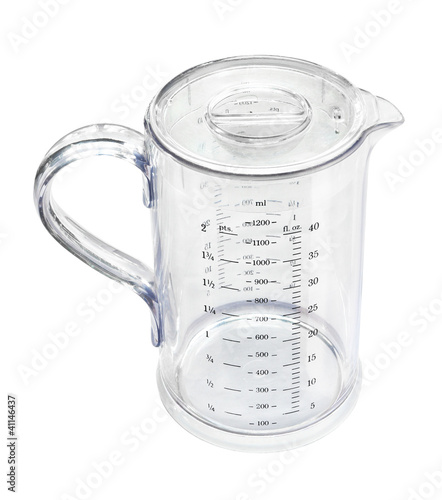 Measuring transparent jug isolated on white background